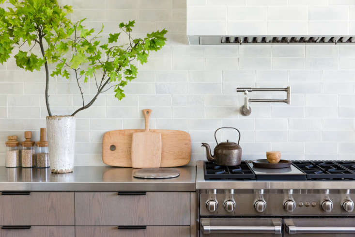 The back counter is brushed stainless steel. Note the pot-filler faucet above the range: see Domestic Dispatches: Why Your Kitchen Needs a Pot Filler Faucet.