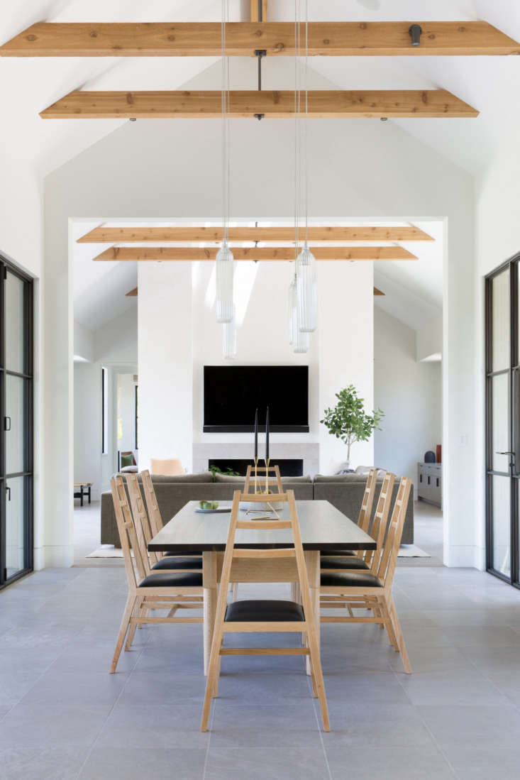 The dining area, with steel-frame doors on either side.