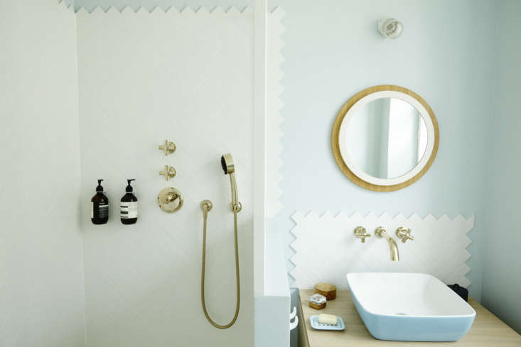 The shower and sink backsplash are patterned with subway tiles that Gesa describes as &#8
