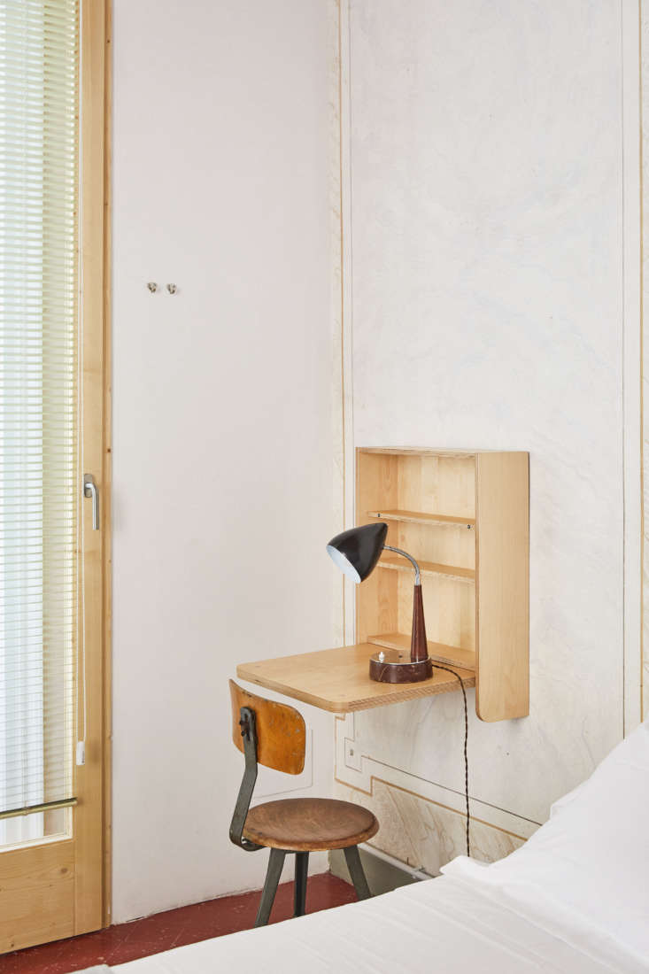 A folding desk and shelving was made custom from Marine-grade plywood.