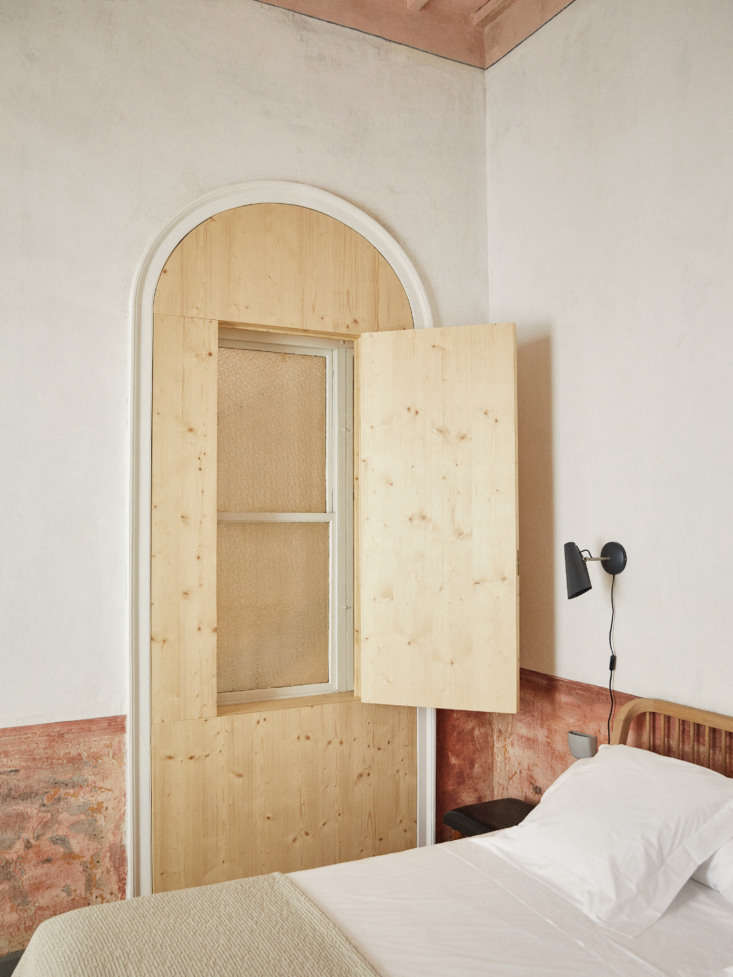 "The window situated within the old door frame was designed by Martí to create a ""false order of things,"" as Ignasi says, along with insulating for sound."