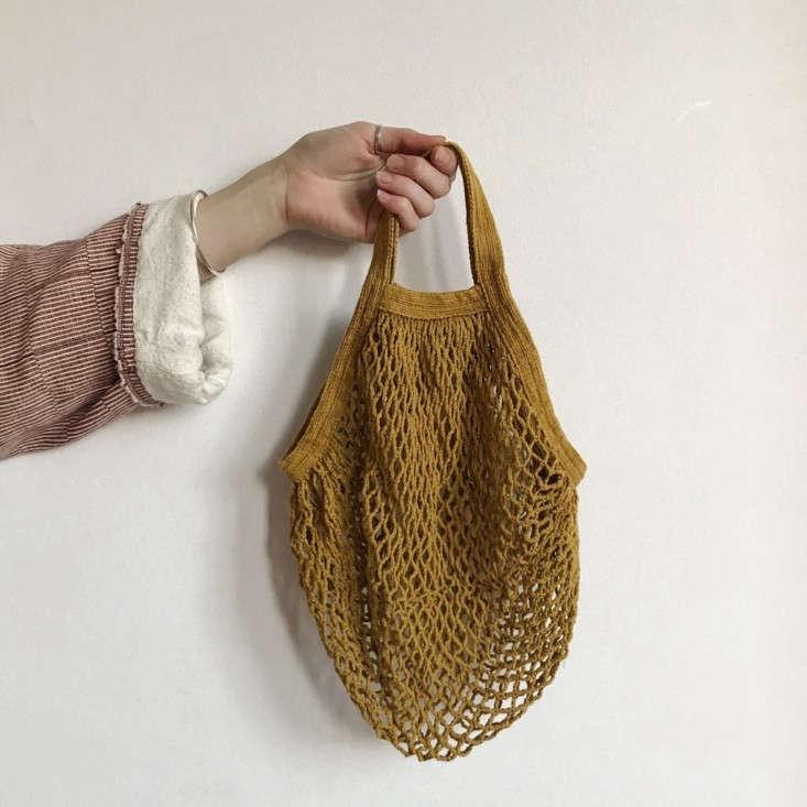 a mustard short handled string bag is €\20. 14