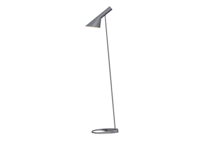 Arne Jacobsen designed the AJ Floor Lamp as part of his 60 collection for Louis Poulsen. It delivers glare-free, directed light and has become an icon since its first release. Made with a steel shade and zinc base, the lamp comes in  colors; $loading=