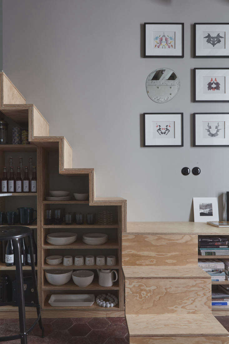 Note how the tabletop also acts as a step in the staircase, which itself leads to a sleeping loft.