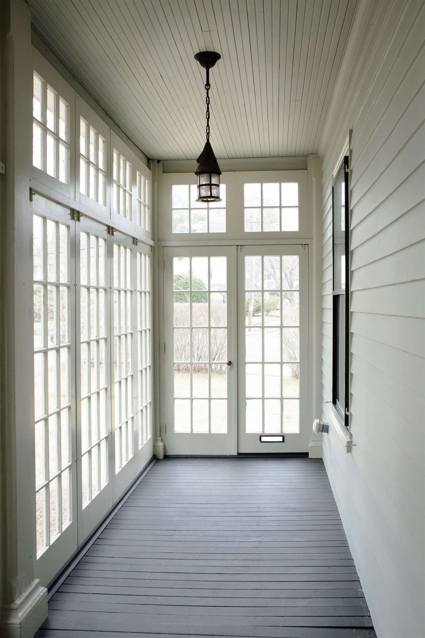My porch looking fresh after the Catchlight crew came through. Detailed work such as window mullions require a steady hand and a lots of time.