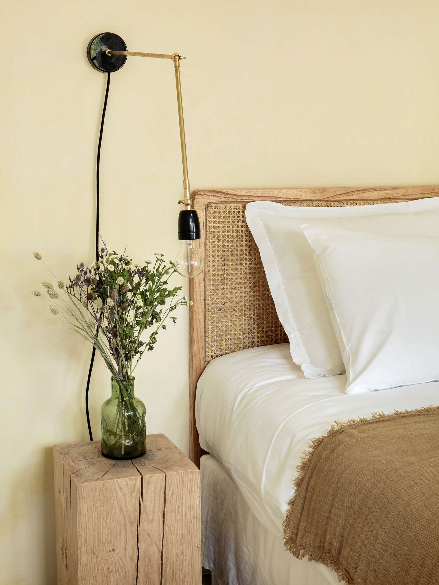 A rattan headboard and Porcelain and Brass Sconce from Zangra.