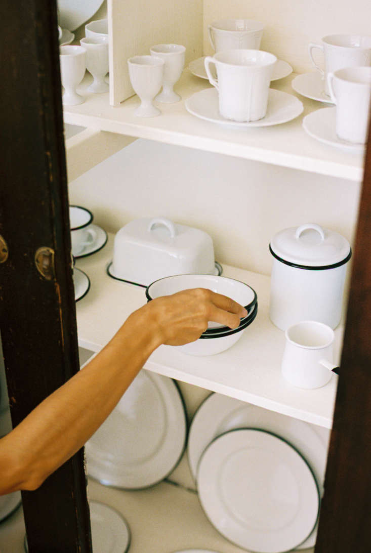 In the cabinet, a slew of enamelware, made in France and Belgium and starting at $6 for a small cup or bowl.