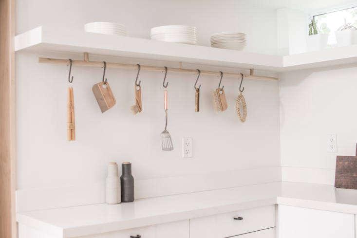 A custom wood rod and S hooks provide hanging storage.
