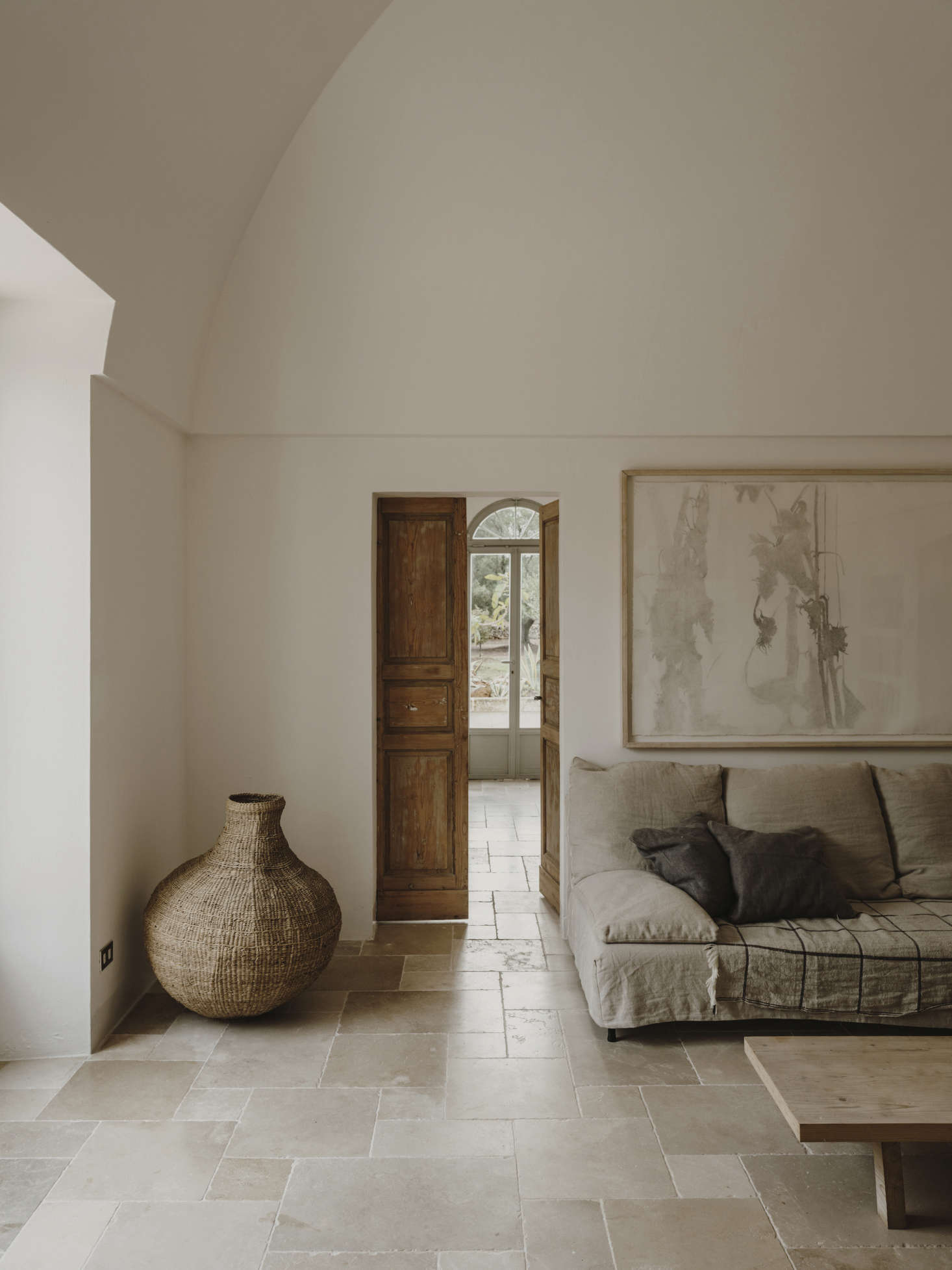 Inside, whitewashed walls meet stone floors and laid-back, linen-covered sofas reminiscent of Trotter&#8