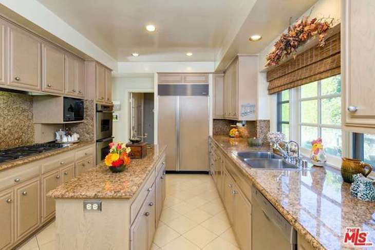 The kitchen was the only part of the house that had been remodeled in recent decades, during the era of speckled granite. The adjacent breakfast room became the wine cellar.
