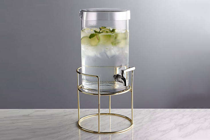 The Crate & Barrel Cold Drink Dispenser is made of glass with a stainless steel spigot. It&#8