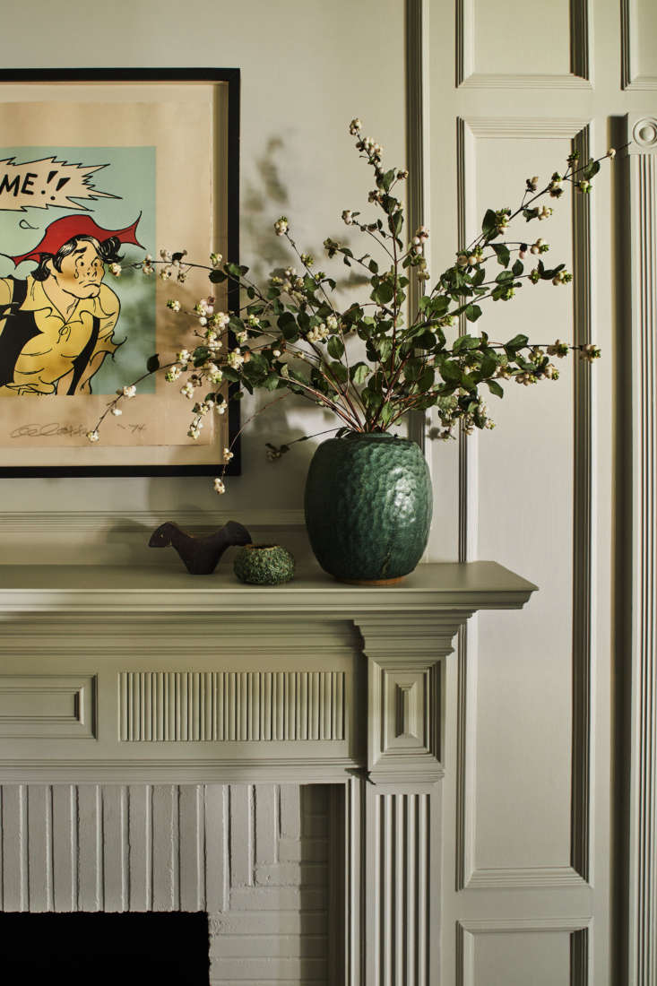 In the den, the original mantel and paneling were updated with fresh paint: satin Collingwoodfrom Benjamin Moore. The Li&#8