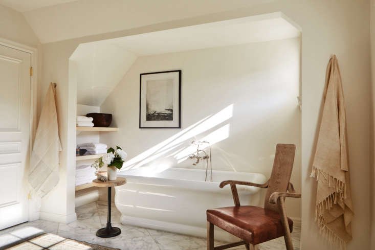 Like the kitchen, the master bath was given a complete rethink. Enlarged (by removing a closet and sitting room with a vanity), it now has a freestanding tub—the Michelangelo from Hydrosystems—set in a sunny niche with shelving at one end and a window in the other.