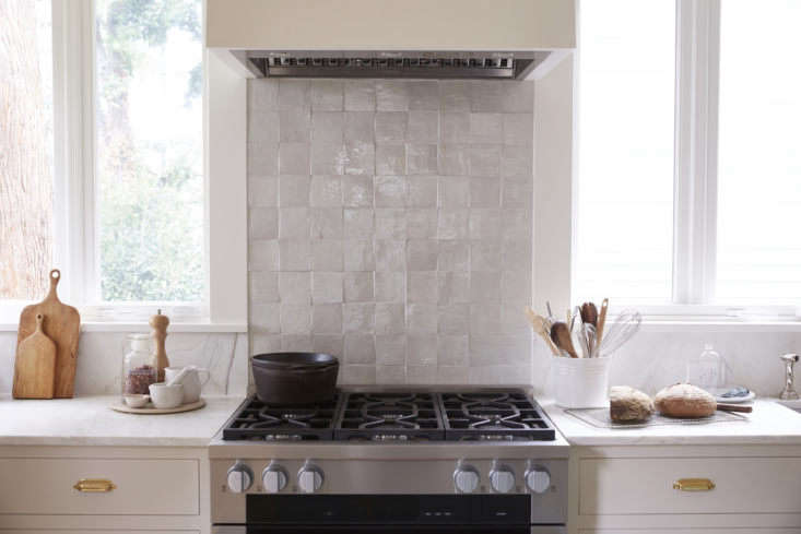 all of the new appliances are by miele. the backsplash is composed of clé tile 12