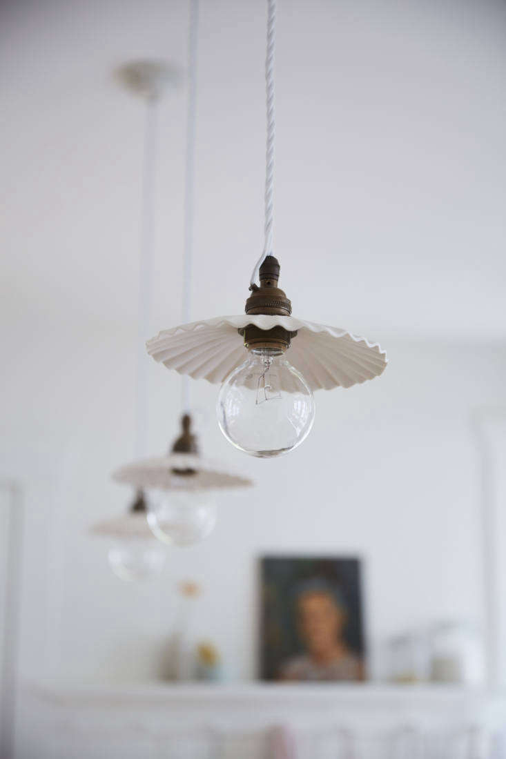a trio of porcelain pendant lights by devol hang over the island. (see new from 15