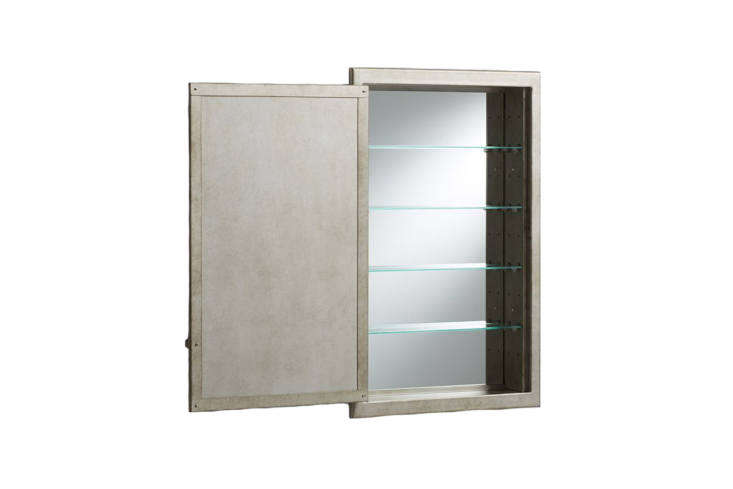 The Pottery Barn Clermont Recessed Medicine Cabinet is made of antique-finished steel and has a mirrored interior; $349 to $449.