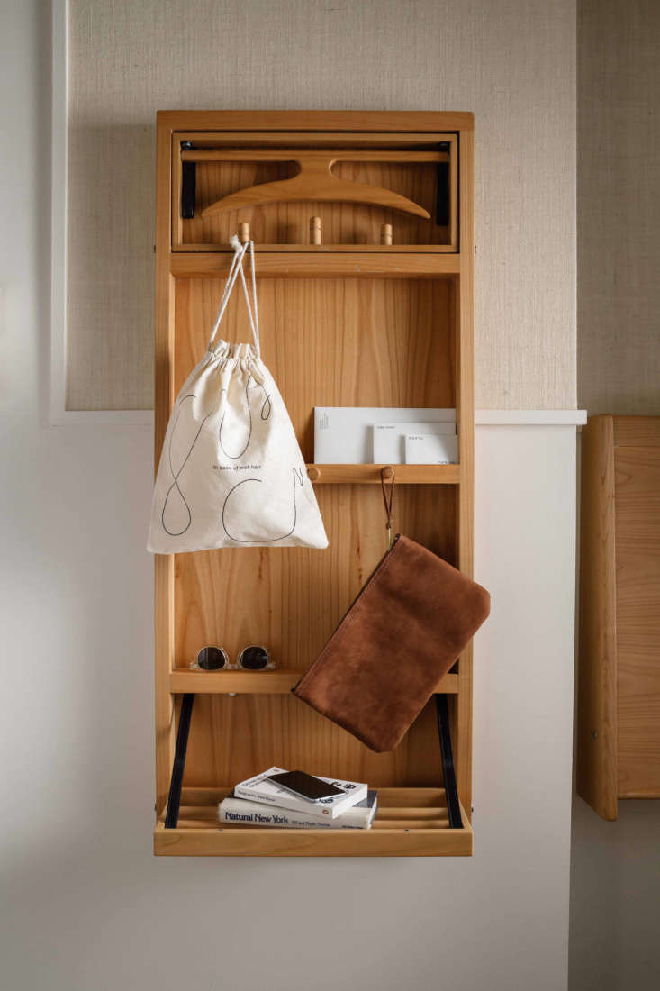 The wall-mounted wardrobe has a Shaker look and feel.