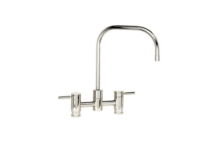 10 Easy Pieces Modern Bridge Faucets The Waterstone Fulton Suite Bridge Faucet with Side Spray has a slender spout and comes in a whopping 3\1 different finishes; \$\1,7\25 at Quality Bath.