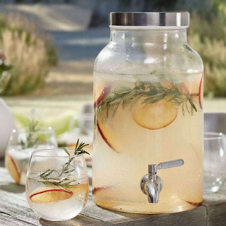 The West Elm Infuser Drink Dispenser has a stainless steel spigot and lid; $49 at West Elm.