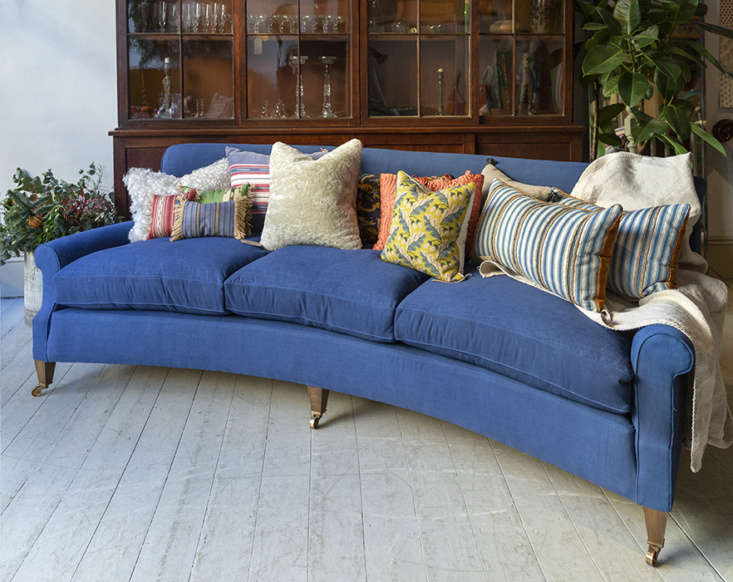 When most curved sofas take on a modern silhouette, Howe in London keeps their take classic with the Hound Sofa. Made with hand-stitched horsehair and down cushions, the Hound comes in three different lengths and the option for fabric or leather upholstery. Contact Howe for price and ordering information.