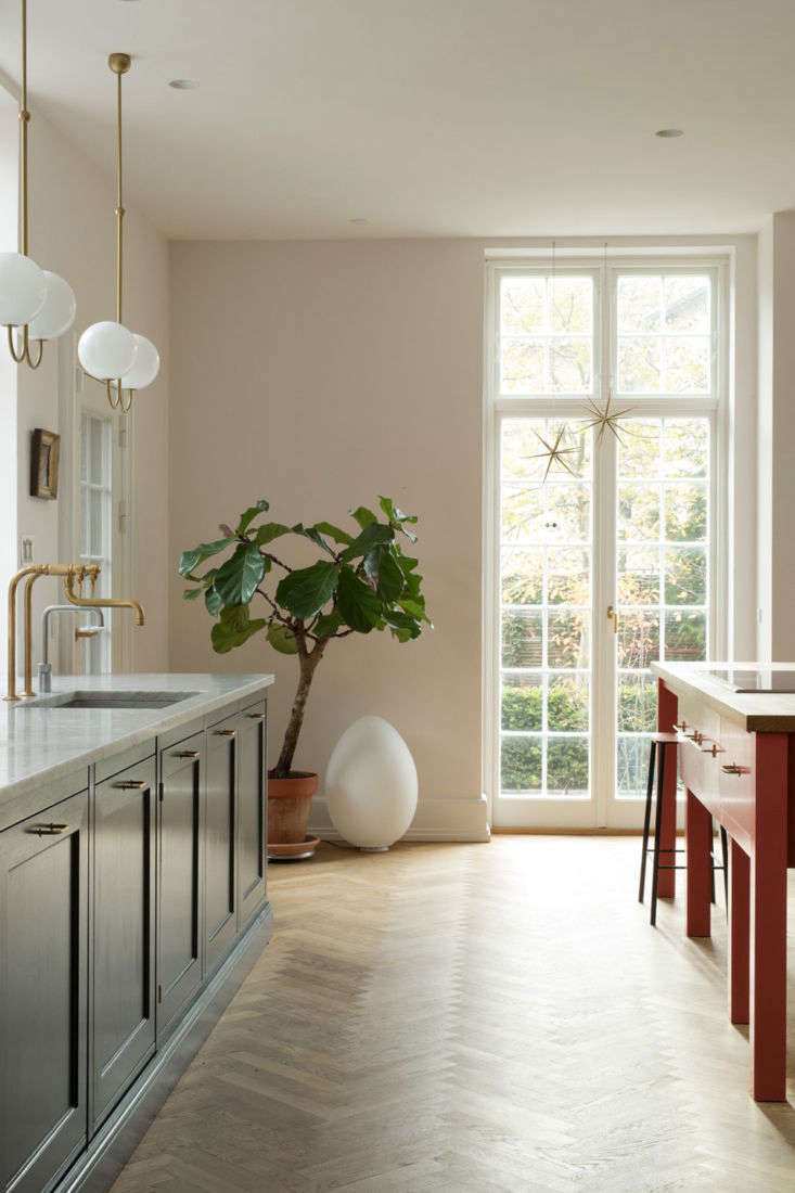 The room is painted Nights in White Satin, a color from Danish firm File Under Pop that changes in the Nordic light from a warm white to palest pink (for similar shades, see Architects&#8