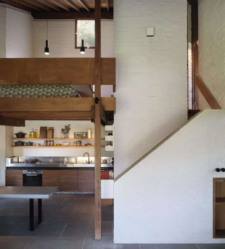 a sleep loft is just above the kitchen. all the wood used for the house&#8\ 12