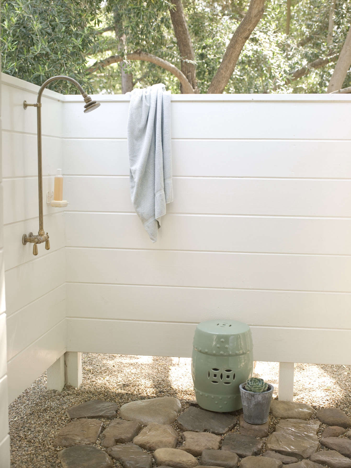 The added outdoor shower, paved with natural stones. Not shown: the studio&#8