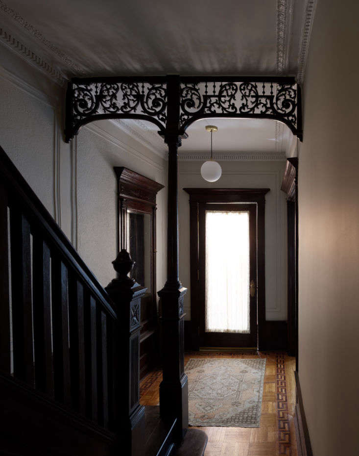 the dramatic first floor hallway, with elaborate moldings preserved, sets the s 10