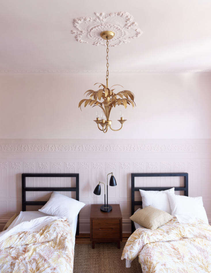 the girls&#8\2\17; room has a pink on pink scheme tempered by black and a b 23