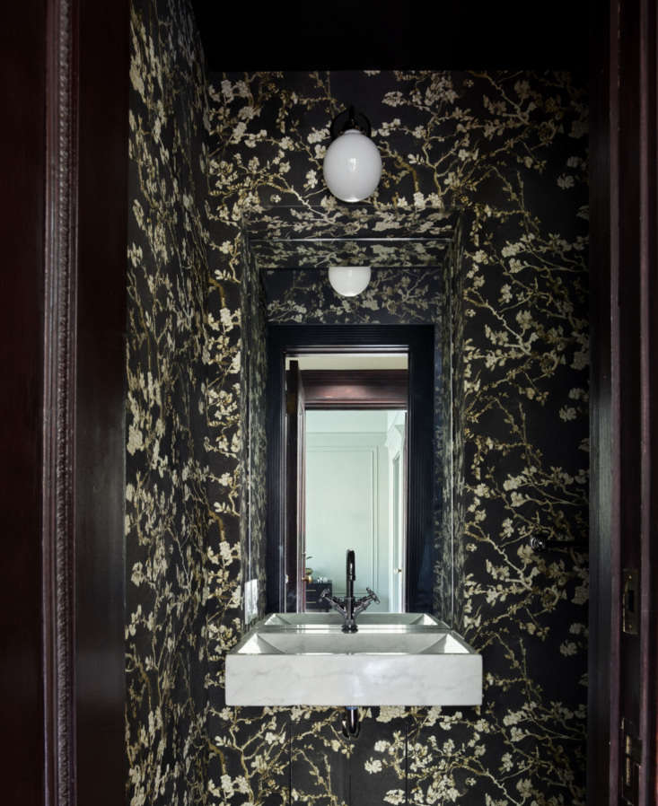 a new half bath on the second floor is papered with a floral find, &#8\2\20 21