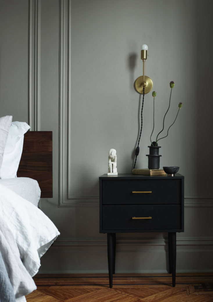 sculptural flowers on the nightstand. the bedside lights are the astrid sconces 18