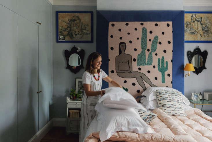 Heuman tidying up her bedroom. &#8