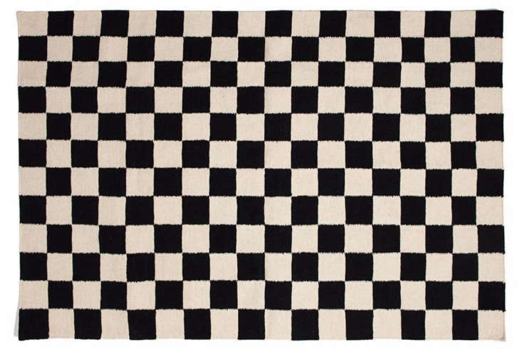 Jonathan painted the black and white checkered floor himself. For a great DIY tutorial, go here. Not up for the project? Consider this wool and cotton Checkmate Flatweave Rug by Aelfie; $89 to $loading=