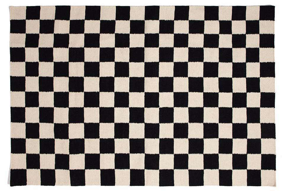 Jonathan painted the black and white checkered floor himself. For a great DIY tutorial, go here. Not up for the project? Consider this wool and cotton Checkmate Flatweave Rug by Aelfie; $89 to $src=