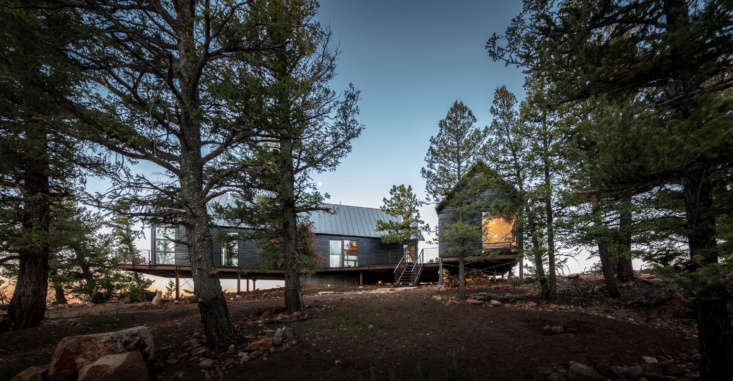 Connected to the main house by a deck, a second smaller cabin houses two bedrooms for Blum&#8