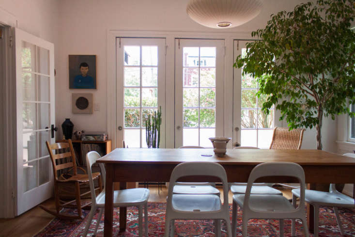 A -year-old ficus, gifted by a friend, anchors a corner of the dining room. In the other corner, a painting of Spock, found at a flea market, holds court. Ikea dining chairs surround an antique farm table.
