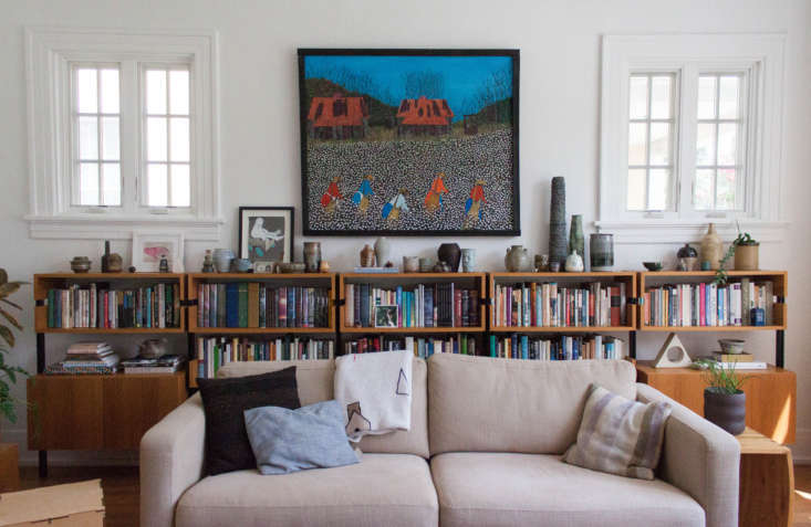 Hanging above the bookcase by Modern Shelving is a Valton Murray painting. &#8