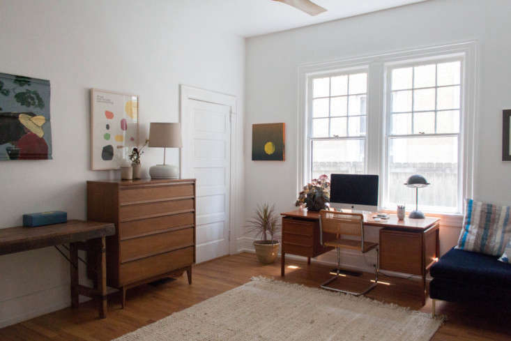 The office is appointed with mid-century vintage furniture.