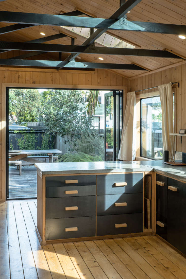 The kitchen island is framed with the same wood used throughout and the drawers are plywood with steel fronts. George and Will poured the concrete counter themselves in their workshop: &#8