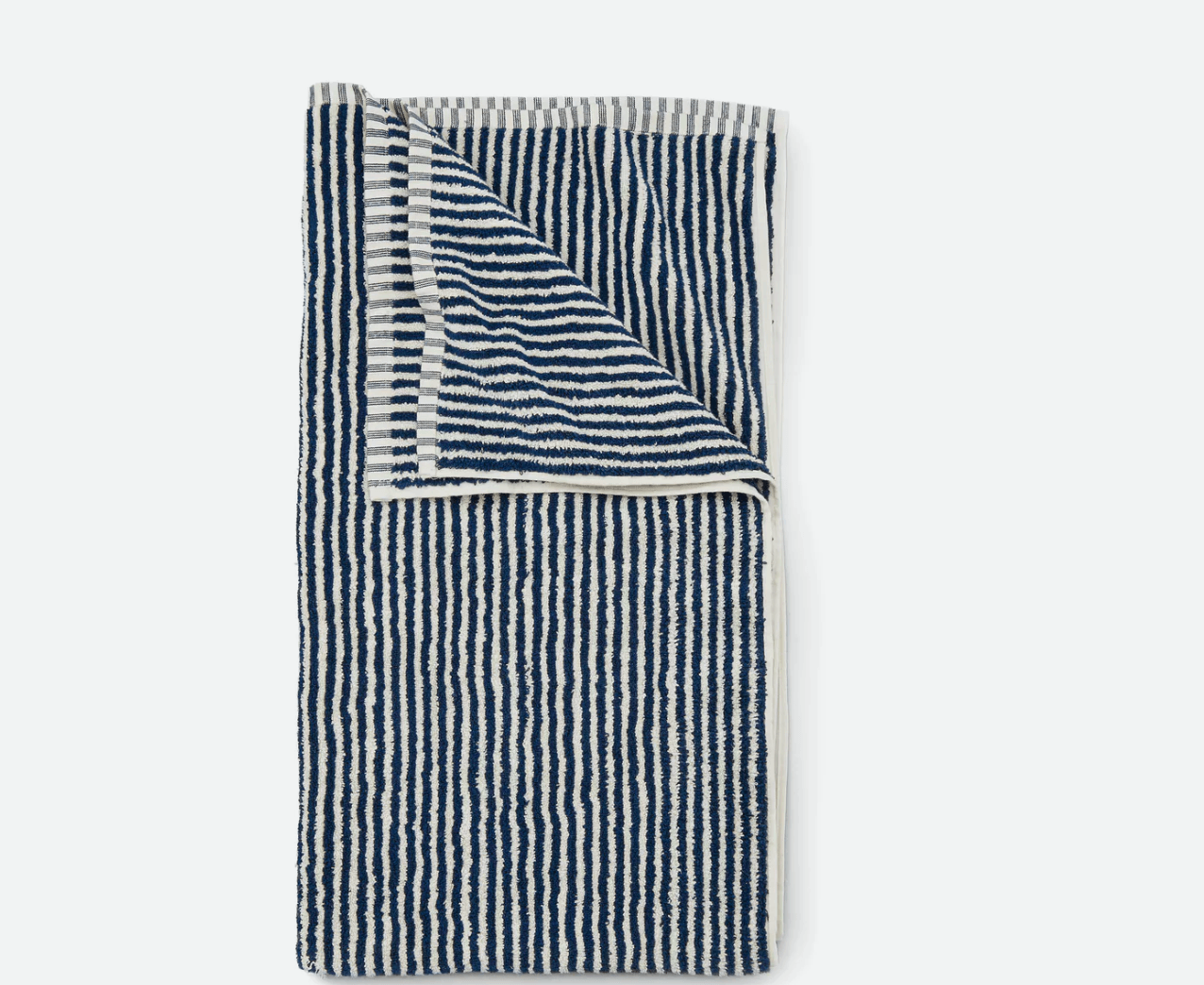 The Striped Beach Towel from Huckberry is available in navy/cream (shown above) or spring green/cream; $.98.