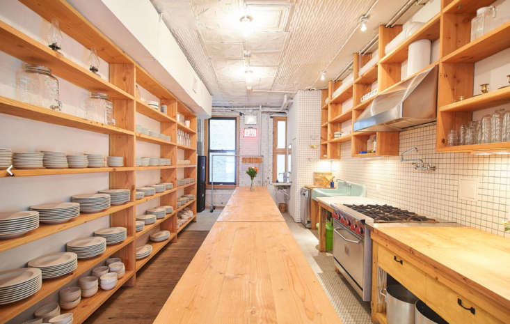 All the wood shelves and tables were designed by Poe. The built-ins in the kitchen are his homage to Donald Judd&#8