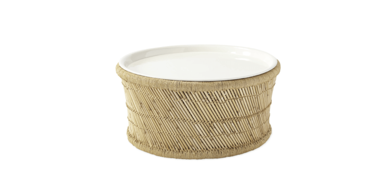 The bamboo/jute Market Coffee Table from Serena & Lily is available with a white or navy enamel tray top;  $498.