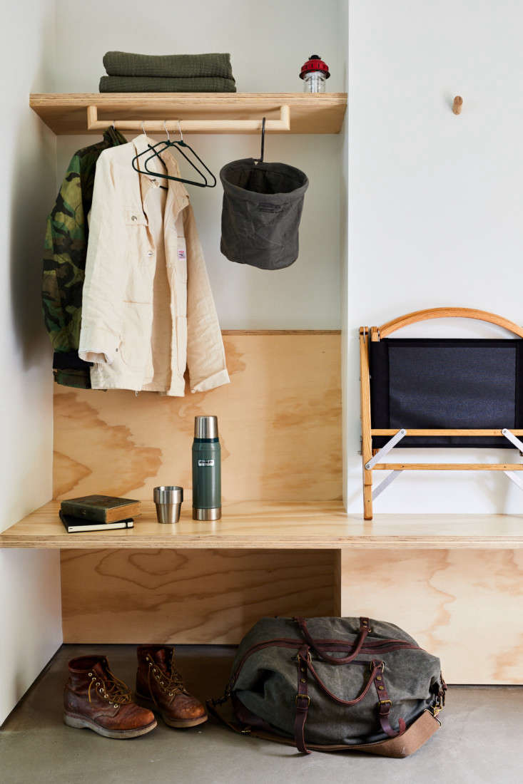 The entryway to a guest room. The folding camp chair can be purchased from the hotel shop.