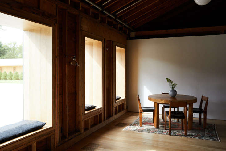 A quiet corner in the lobby. Oversized casement windows flood the space with light.