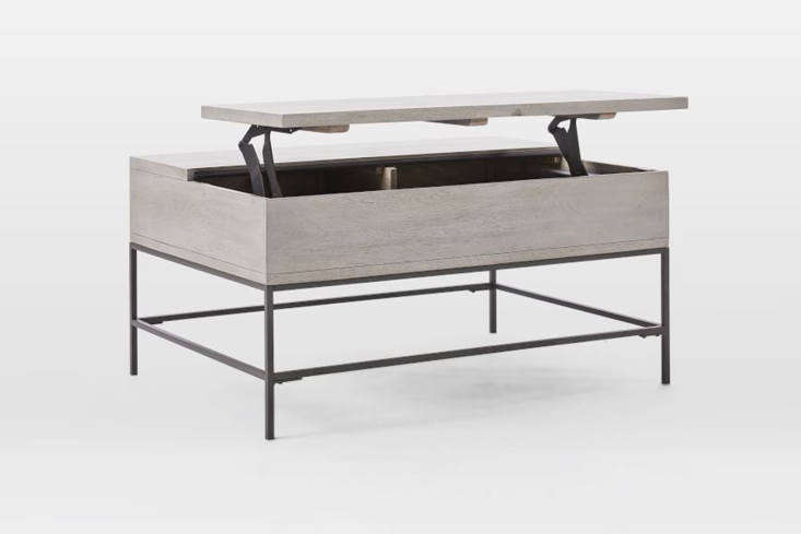 The West Elm Industrial Storage Pop-Up Coffee Table in Gray opens to reveal a storage component and the elevated portion can be used as a workspace and raised tabletop; $599 at West Elm.