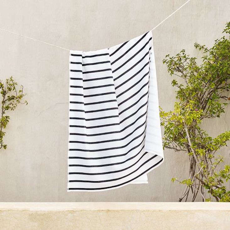 The Riad Striped Beach Towel from The White Company is available with gray or black stripes (show above); currently on sale for $34.30 (down from $49).