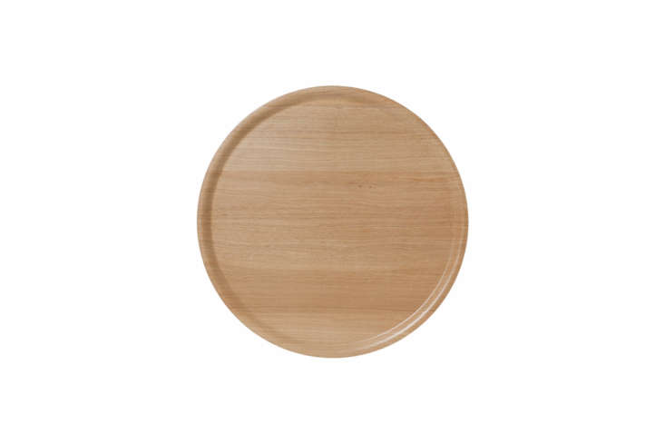 The Bengt & Lotta Wood Large Round Tray in laminated oak is $5
