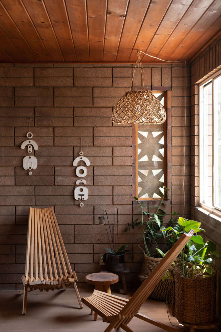 the lamp and wall hangings are all by wilkinson. for similar foldable chairs, c 13