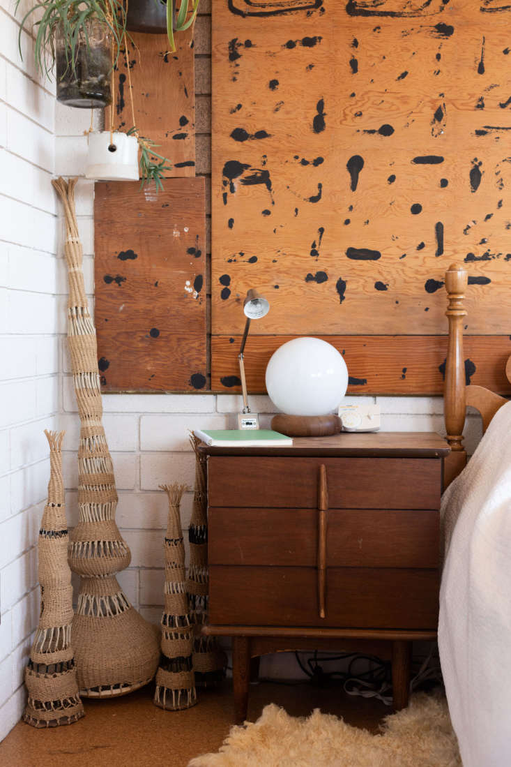 a trio of woven works anchors a corner of her bedroom. the pollock esque wall b 14