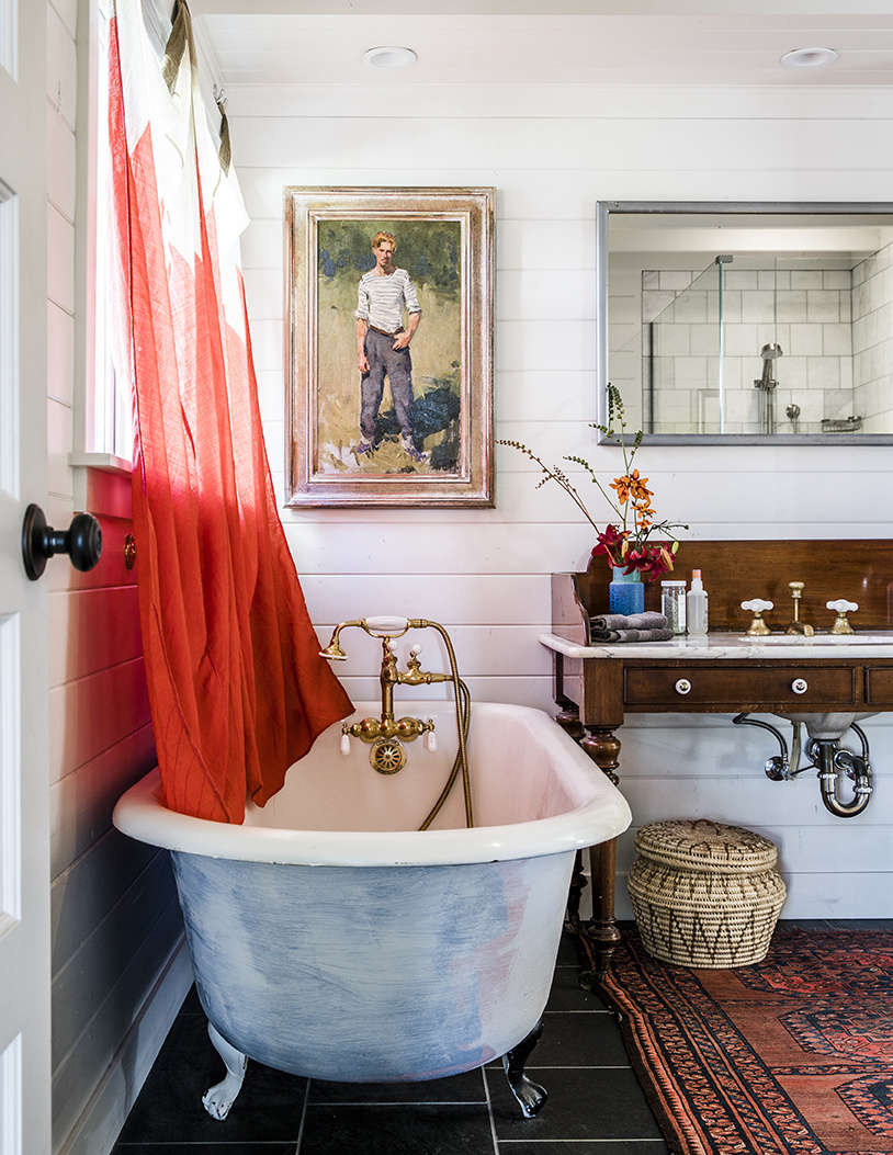 Also from Second Use: the circa-s tub in the primary bath. A pair of signal flags found in Provincetown make charming curtains.